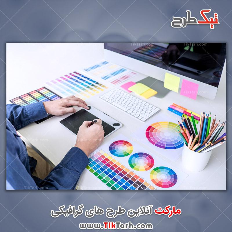 دانلود تصویر با کیفیت طراح خلاق طراحی گرافیکی رنگی با تبلت