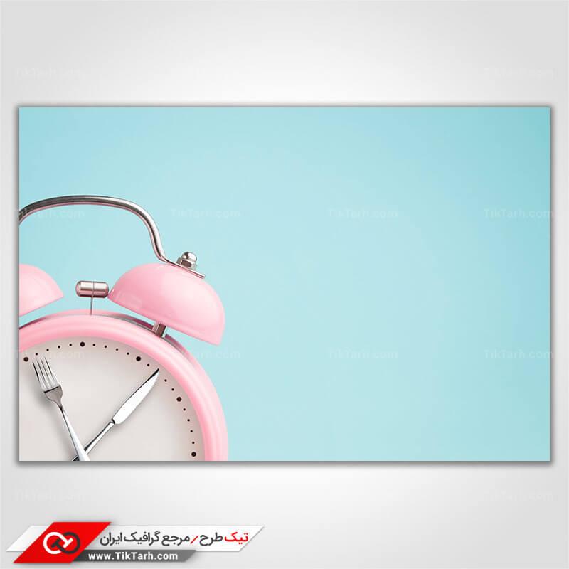 عکس با کیفیت ساعت با طرح کارد و چنگال