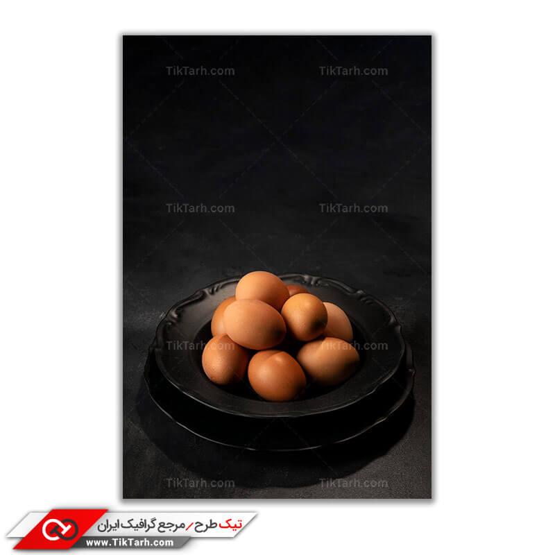 دانلود عکس گرافیکی تخم مرغ های محلی با پس زمینه ی سیاه