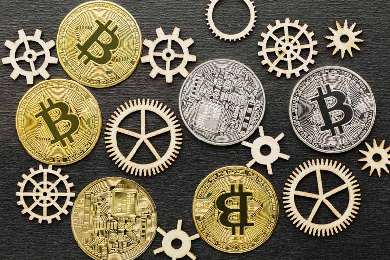دانلود تصویر سکه های بیت کوین و چرخ دنده ها