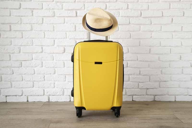 دانلود تصویر کلاه و چمدان
